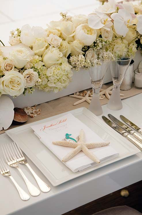 Each guest's place setting features a personalized menu and an exquisite starfish.