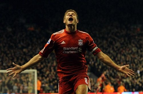 Steven Gerrard wheeling away to celebrate his first goal of the night against Everton at Anfield (13/03/12)