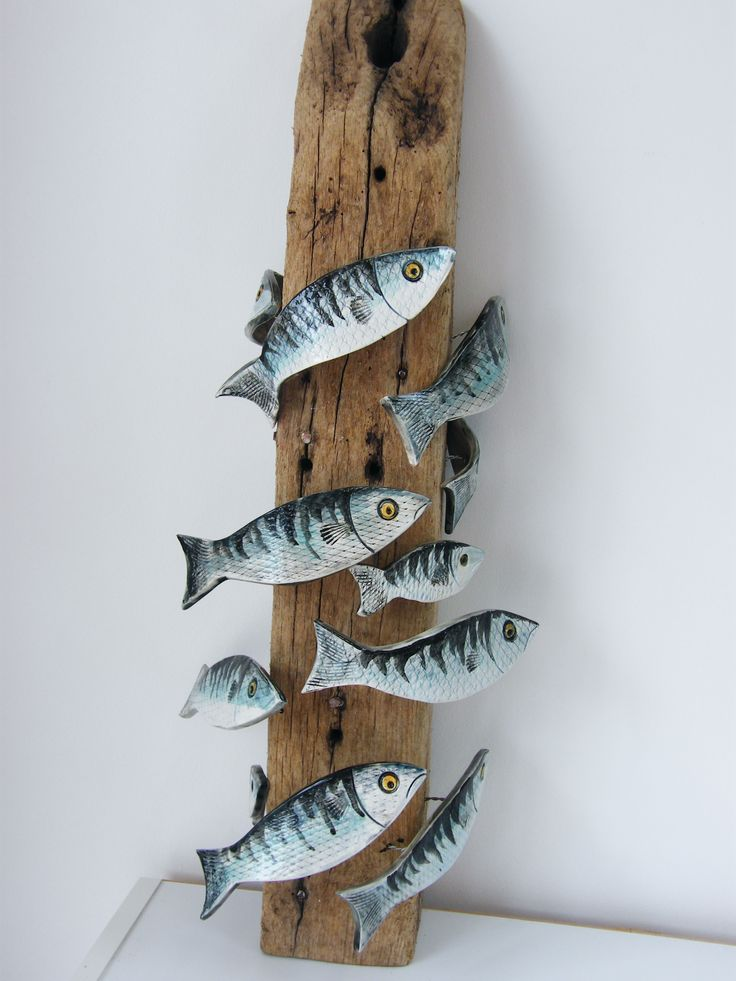 new work ! ceramic fish on driftwood post.