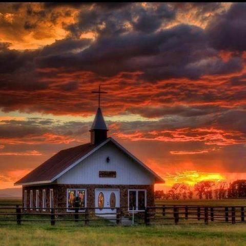 Beautiful sunset over old country church