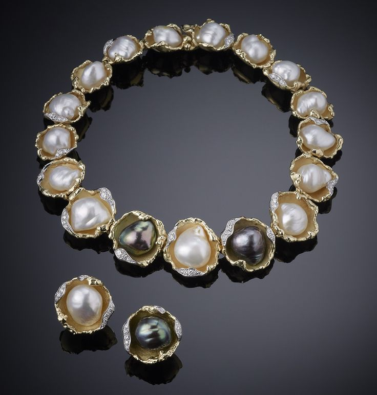 "Vintage Grima necklace and earclips with baroque pearls, held in yellow gold and diamond ""oyster shells"", 1972."