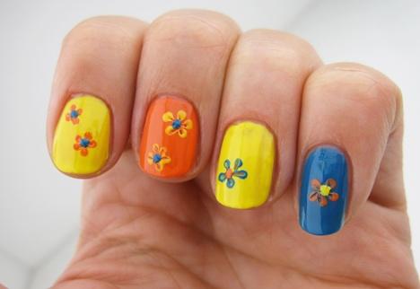 Nail Art Tutorials for Beginners – and Pros too!  Learn a super simple flower technique that anyone can recreate! Nail Art anyone can do, via #TargetStyle