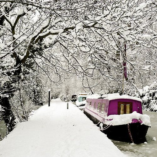 Snow on canal boats in England