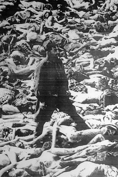 """In this famous photograph, Dr Fritz Klein is standing in a mass grave at Bergen-Belsen concentration camp; his main duty was the selection of prisoners to be sent into the gas chambers. From 1942-1944 transport trains delivered Jews, Romani, people with disabilities, Soviet war prisoners, homosexuals, Jehovah's Witnesses and other political and religious opponents to """"forced labor camps"""".... And they try to tell us these things never happened ...."""