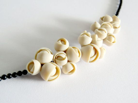 Polymer clay flower necklace with geometrical roses and by eried
