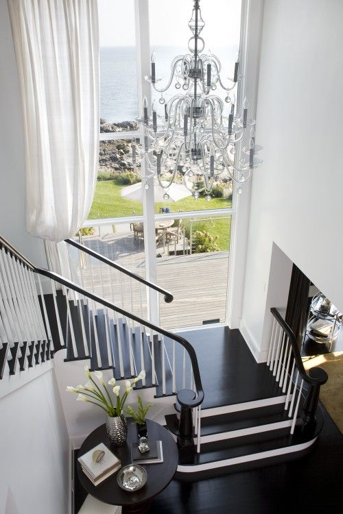 B-E-A-UTIFUL. Love the long curtain with the huge window at the landing. Like the dark stair tread with the white stair rise too.: Black Stairs, Big Windows, Black And White, The View, Dream House, Black White, High Ceilings, White Wall, White Stairs
