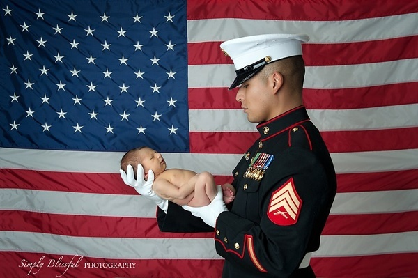 My favorite Father and Son photo of all. Baby LZ at one week old with his  Daddy in full U.S. Marine Corps. dress.
