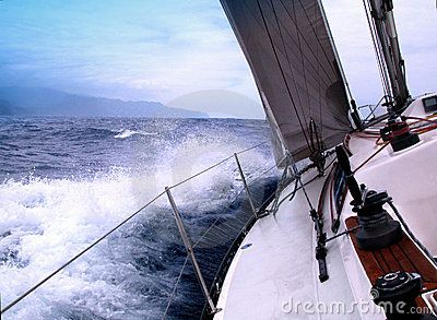 Sailing with strong wind to the coast