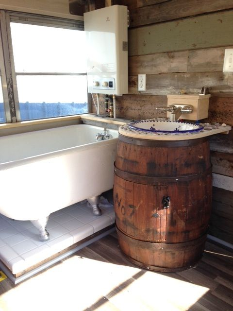 Love the barrel sink and tub in this converted school bus.