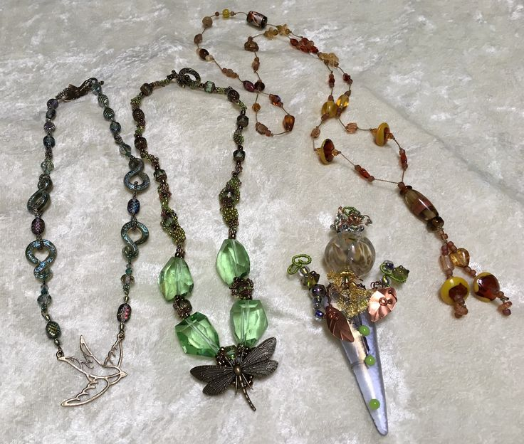 These are the items I made with the beads I received.  1 Brooch and 3 necklaces. Not sure why the photo is not showing up until you click on it.  Sorry :(