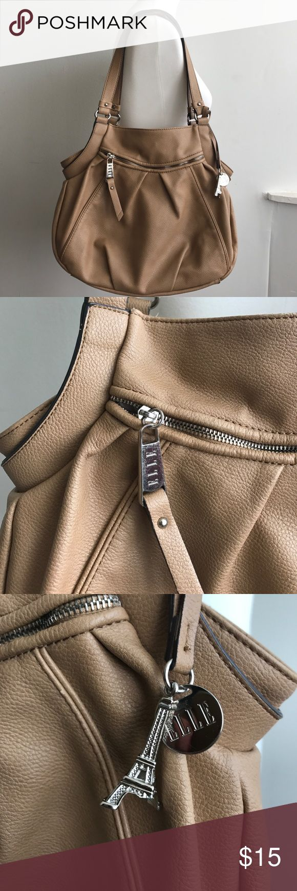 Elle Handbag Tan Shoulder Bag Purse This post is for an Elle Tan Handbag. It has some imperfections that can be seen in the pictures. Let me know if you have any questions. Thank you for looking! Elle Bags Shoulder Bags