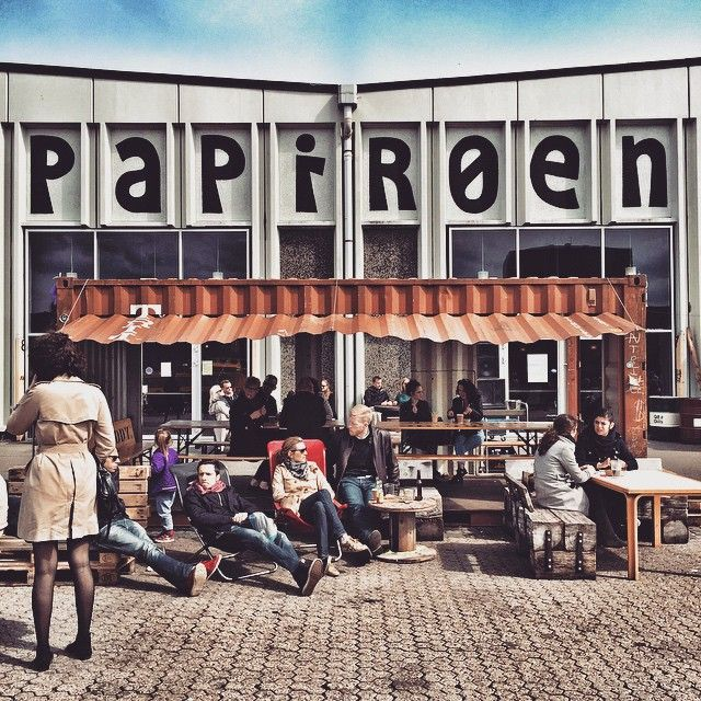 """Papirøen   Cat: """"Food markets (good atmosphere and cheap)"""" Domaine: """"Filled with dozens of stalls, each offering a delicious speciality, the Papirøen is a great place to chill, eat, drink, and watch the boats pass the canal. After lunch, check out Experimentarium City next door. The hands-on science and technology museum is the perfect way to walk off our favorite pulled pork and spare rib sandwiches."""""""
