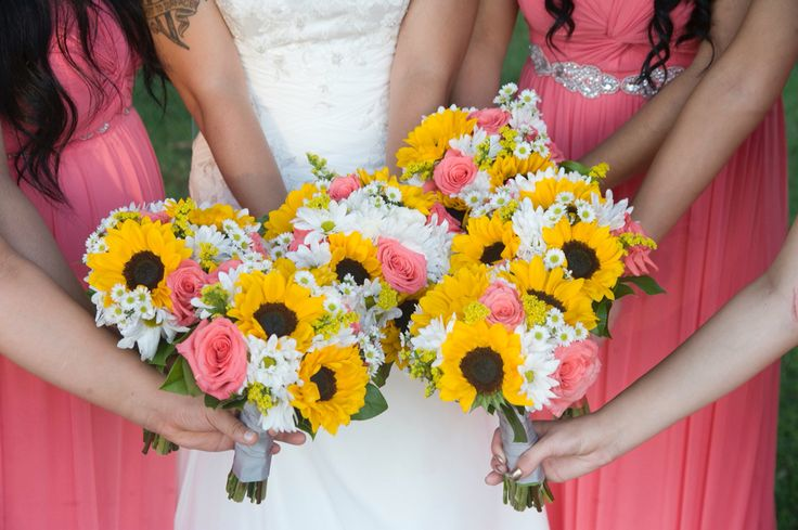Sunflower, daisy, coral rose bouquets. The flowers were absolutely beautiful from Town and Country Gardens.