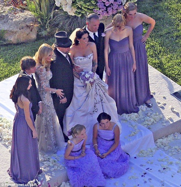 Sandra Bullock's ex Jesse James shares picture of his tattooed bride after wedding No. 4.
