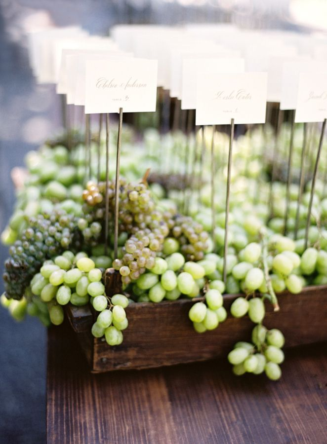 Napa-inspired grape escort cards: http://www.stylemepretty.com/2015/11/16/fall-beaulieu-gardens-wedding/ | Photography: Jose Villa - http://josevilla.com/: