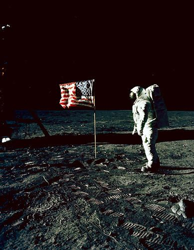 <p><strong>Inverted Flag</strong><br /> Apollo 12 astronaut on the surface of the moon in a captivatingly inverted oddworld shot.</p>