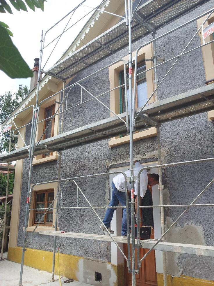 Enduit projeté sur murs extérieurs