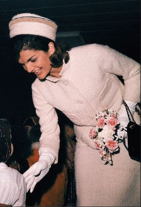 Jackie Kennedy speaking to a little girl at Fashion Show, 1962