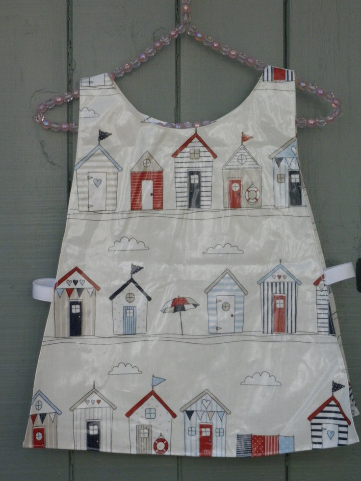 Beautiful Beachhuts oilcloth tabard, in red and navy. www.etsy.com/shop/dagenaisdesign