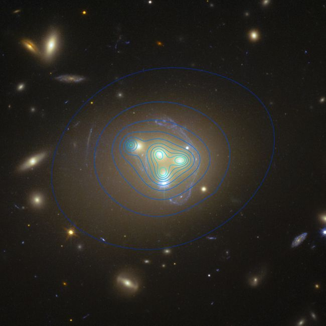 The distribution of dark matter in the galaxy cluster Abell 3827 appears as blue… – Carolyn Pope