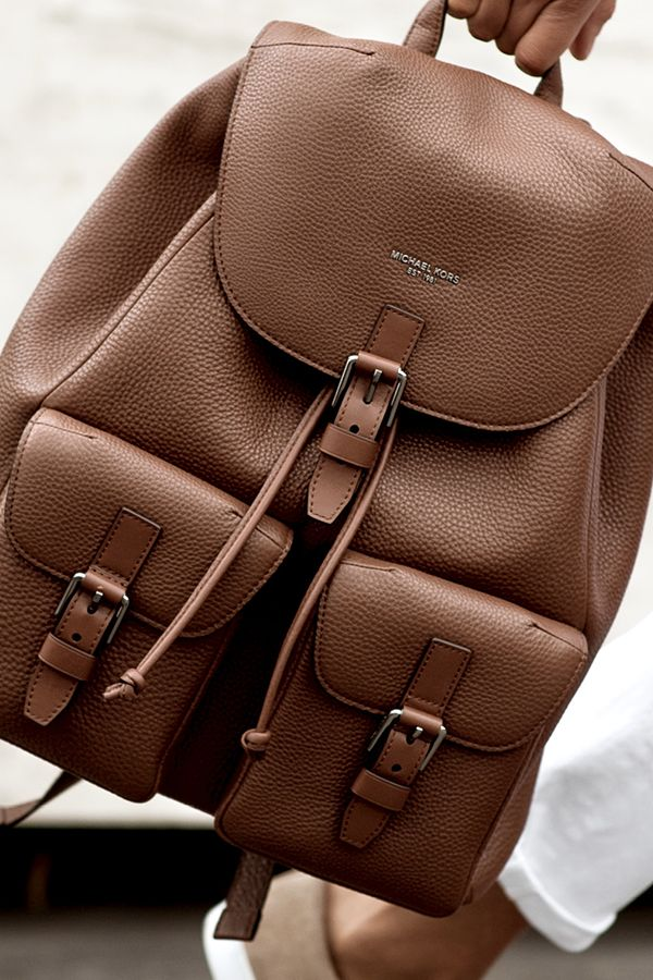 This Father's Day, it's all about the men's backpack. The Bryant backpack is crafted from pebbled leather for a refined attitude. Its sleek flap pockets and top-notch functionality ensure this cool bag is practical, too. It's the perfect travel companion for quick weekend getaways or as a long-haul carryon option. It's also perfect for his daily commute. Get the best Father's Day present for him today on www.michaelkors.com! #ToTheMan
