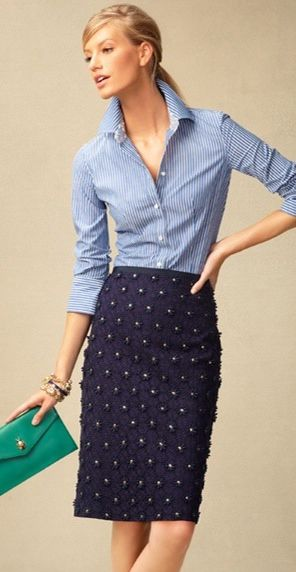 Light blue pinstriped chambray or seersucker button down with an embellished navy blue skirt & a green color pop clutch
