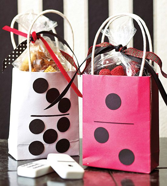 Entertain your guests all the way home with domino-theme goody bags.
