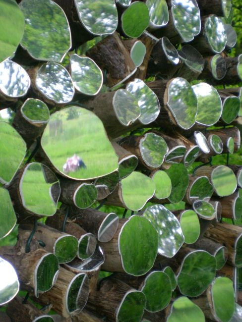 """Sky Trail"", an art installation of wooden stumps fitted with mirrors to reflect the sky or surroundings"