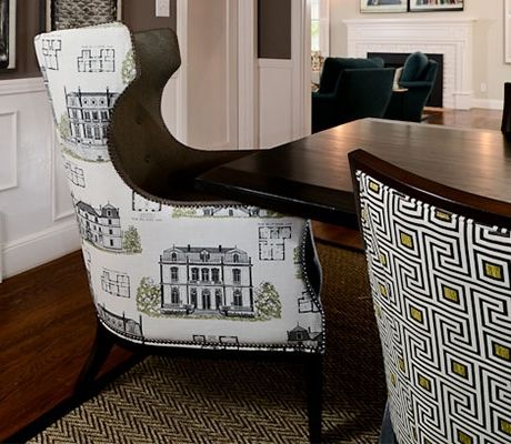 Chairs with high armrests can add a formal air to a dining room, and they also make it easier to move from seated to standing.