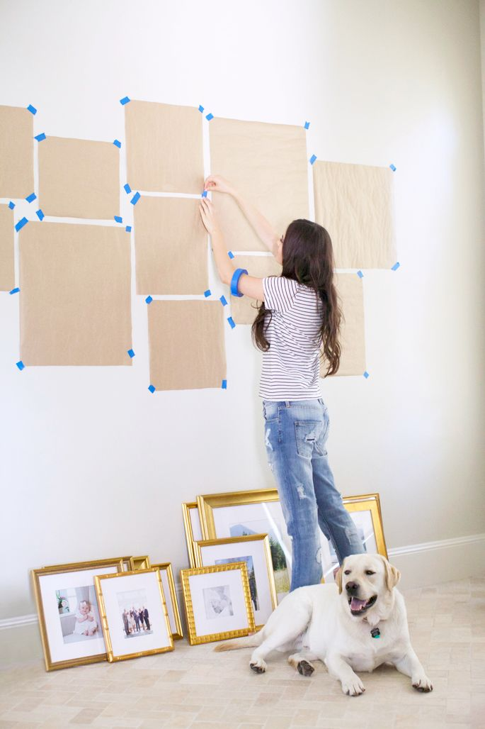 Map out your gallery wall by tracing your frames onto kraft paper. Stick them on your wall with removable tape to experiment with layouts. #GalleryWall