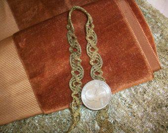 Francese stretta metallo oro antico assetto