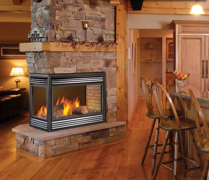 """Wish mine looked like THIS. Rock """"chimney"""" all the way to the ceiling plus a mantle on all three sides."""