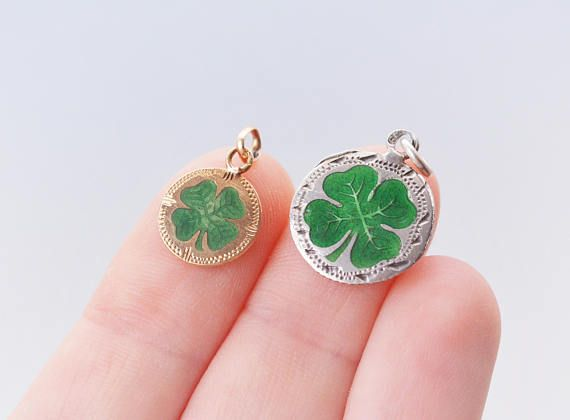 These are two rare old hungarian made good luck charm clover pendants. Both are for sale, chose one or both at a lower price! They have green enamel and are made in great detail. Gold: the gold one is smaller: 16 x 10.5 mm with bale, shiny Silver: 14 x 20 mm with bale, bright green
