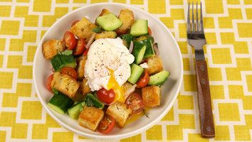 Use up leftover bread in this Panzanella Salad with Poached Eggs