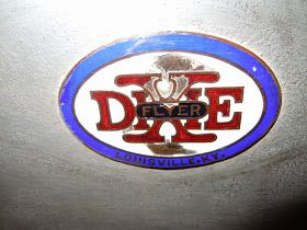 DIXIE FLYER radiator emblem; no maker´s mark     Dimensions 3 7/8 inch x 2 1/4 inch  Year 1920 - 1923   Estimate        The DIXIE FLYER w...