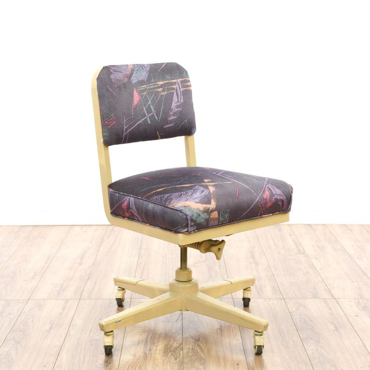 This retro industrial office chair is featured in a durable metal with a shiny beige finish. This desk chair has a rolling swivel base with an adjustable seat and purple 80's print upholstered cushions. Great for a home office workstation! #americantraditional #chairs #swivelorofficechair #sandiegovintage #vintagefurniture