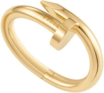 in the midst of home remodeling, so this yellow gold cartier nail bangle is especially appealing