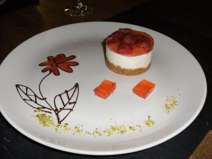 Strawberry Cheesecake on Biscuit Base. Chocolate Work with Coulis & Pistachio