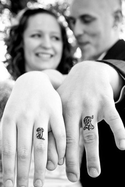Finger couple tattoo