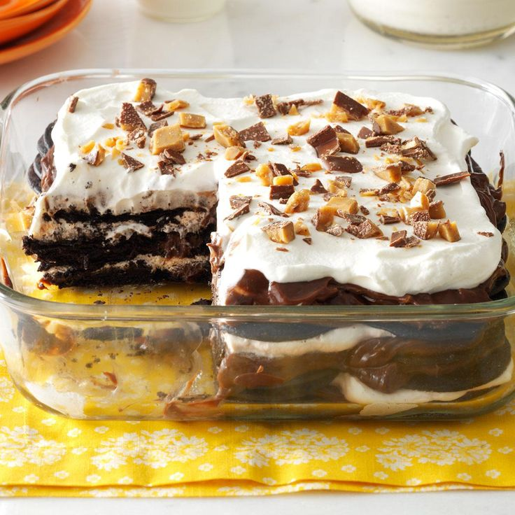 Double-Chocolate Toffee Icebox Cake:   3 cups 2% milk 1 package (5.9 ounces) instant chocolate pudding mix 1-1/2 cups heavy whipping cream 2 packages (9 ounces each) chocolate wafers 2 Heath candy bars (1.4 ounces each), crushed