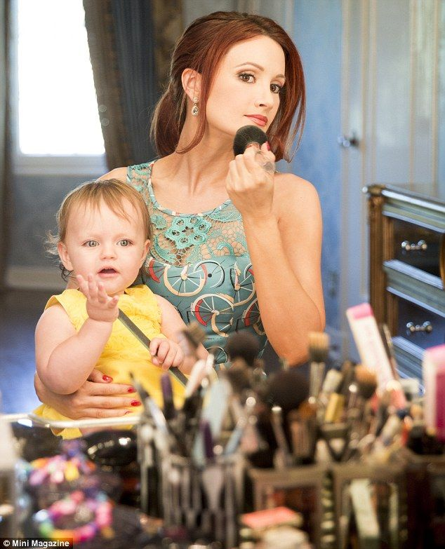 Just like mum: The 18-month-old watched entranced as her mother finished her make-up