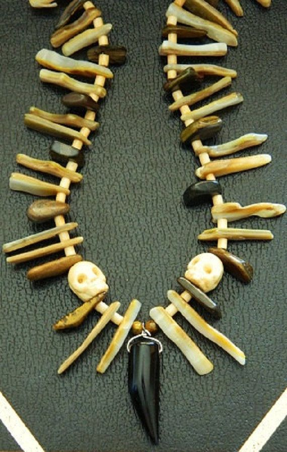 This necklace is made up of the elements of the earth: animal bone, shell, and stone.  Each visually represents parts of the animal and human