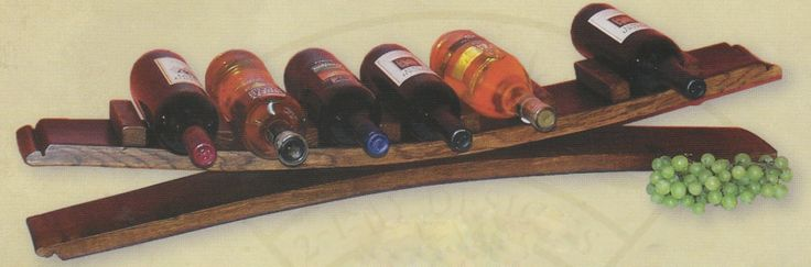 #724 - 7 Bottle Stave Wine Rack - 6x35x5 - $119 + shipping  PERSONALIZATION: 2 line maximum with 15 characters per line. Choose 1 of 2 available fonts.