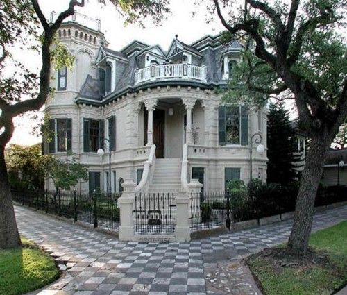 """Galveston TX Gothic - Victorian house. The 21-room mansion features 32 stained-glass windows, four fireplaces and a widow's walk; inside, it's full of opulent Victorian features, including a grand paneled staircase, ceiling reliefs and elaborate chandeliers."""