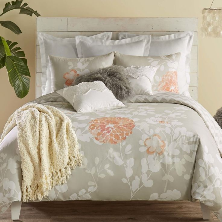 Add a global touch to the modern home with this stylish bedding ensemble. Inspired by bold florals of Easter Island, the Kaleah duvet collection features a wandering botanical print with a refreshing pop of apricot. Set includes 1 duvet and 2 standard shams. The set is 100% Cotton 300 Thread Count. Interior ties on all four corners and three sides of the duvet. Duvet inserts not included. Button closure. Easy care and machine washable. Look for Blissliving Home mix and match accessory…