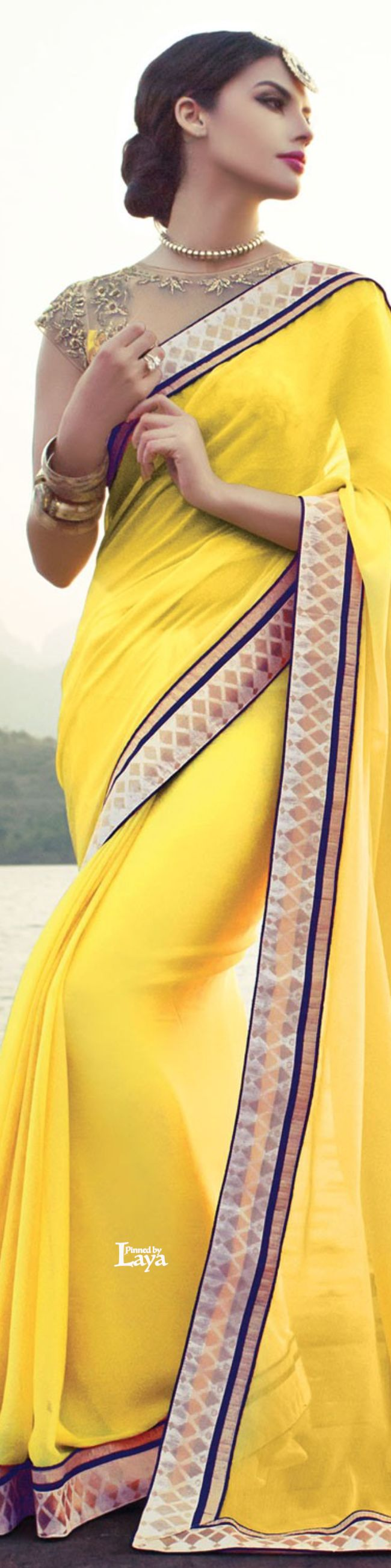 Yellow saree gold border beautiful for a day or night out