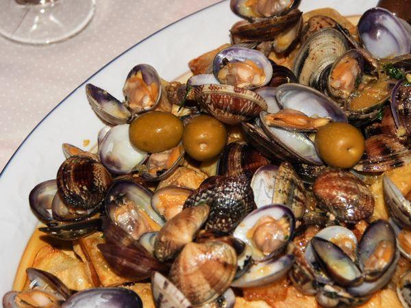una ricetta portoghese, maiale con le vongole
