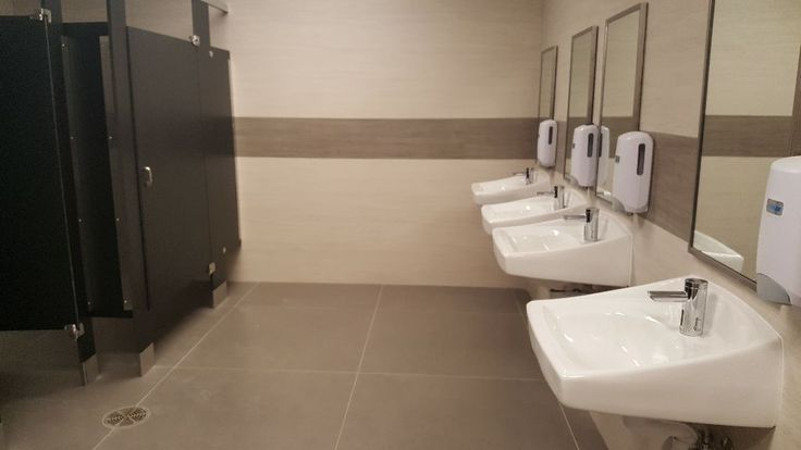 Crossville's gauged porcelain tile panels collections transform restrooms at a Syracuse community college in a tile-over-tile installation that ensured ADA compliance.