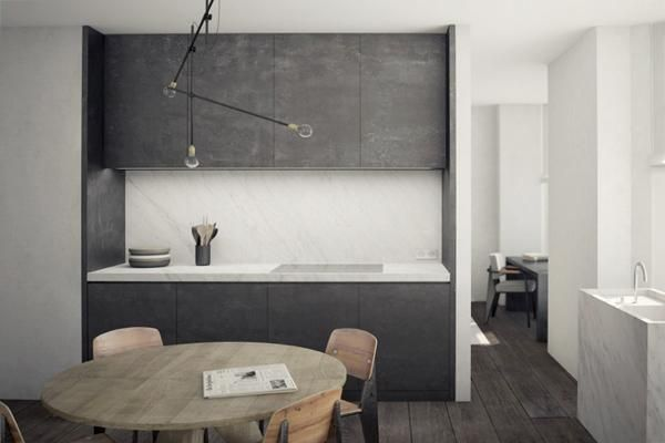 Minimalist gray and white kitchen by Nicolas Schuybroek in Brussels