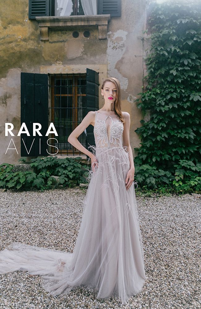 Lace vintage wedding dress 'Adely' with feathers, beading and beautiful neckline. Luxury collection from Rara Avis designer.